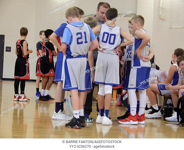 Coach Talking to Youth Basketball Team, Winchester, Massachusetts, USA