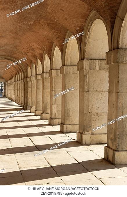The Royal Palace of Aranjuez. Arched walkway. Aranjuez, Community of Madrid, Spain