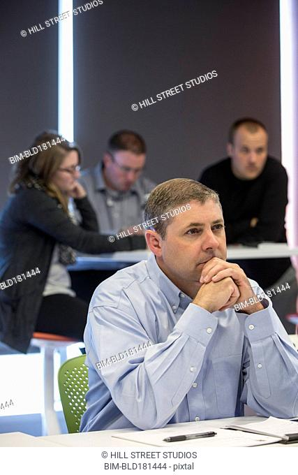 Businessman sitting in office meeting