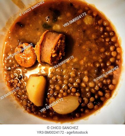 A lentil soup with potatoes and sausage in a home in Prado del Rey, Sierra de Cadiz, Andalusia, Spain
