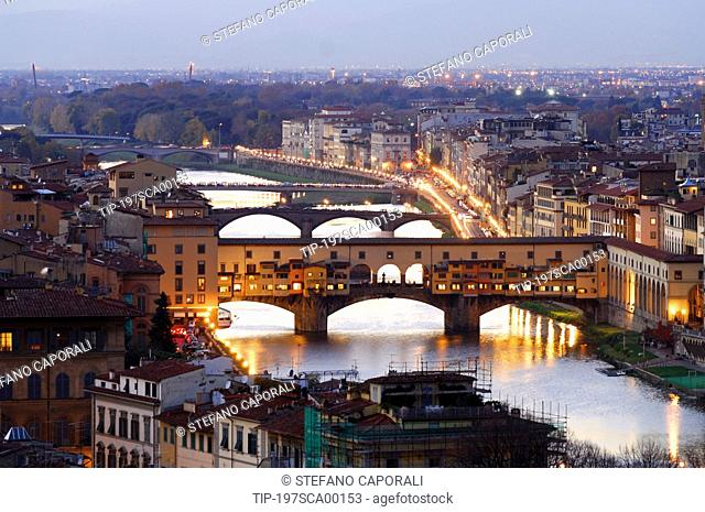 Italy, Tuscany, Ponte Vecchio over Arno River in Florence at dusk
