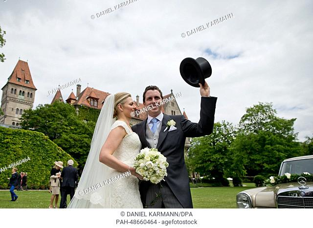 The newly weds Kate Stahl and Count Anton Andreas von Faber-Castell pose after their church wedding outside of Faber-Castell Palace in Stein near Nuremberg