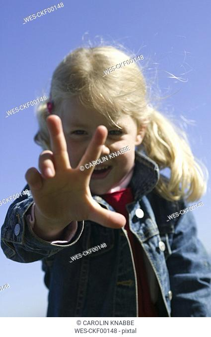 Girl 4-5 showing hand, close-up