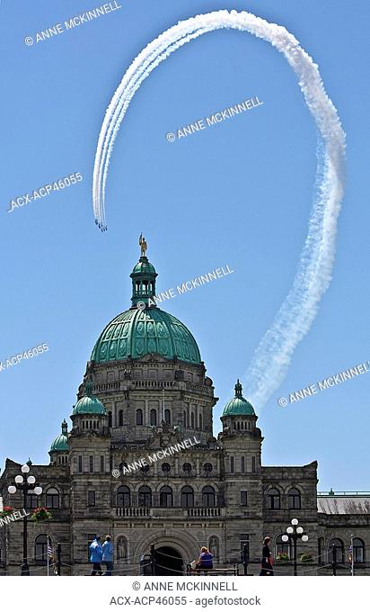 The Snowbirds, a Canadian Air Force aviation team, fly behind the Legislature in Victoria, British Columbia, Canada