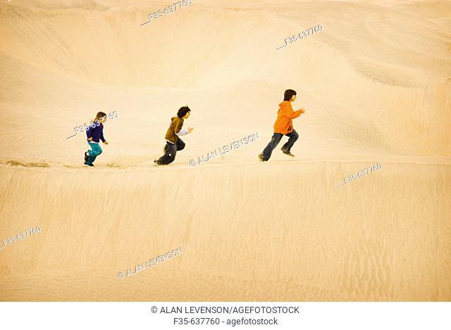 Children run on Sand Dunes, Baja California, Mexico
