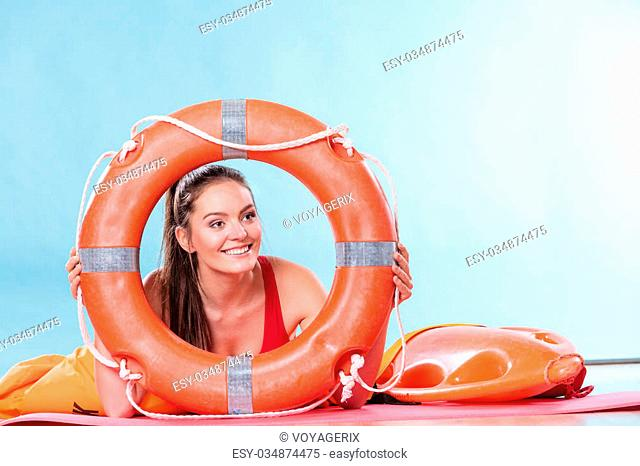 3542b1fab141 Happy lifeguard with ring buoy lifebuoy. Woman girl supervising swimming  pool water. Accident prevention