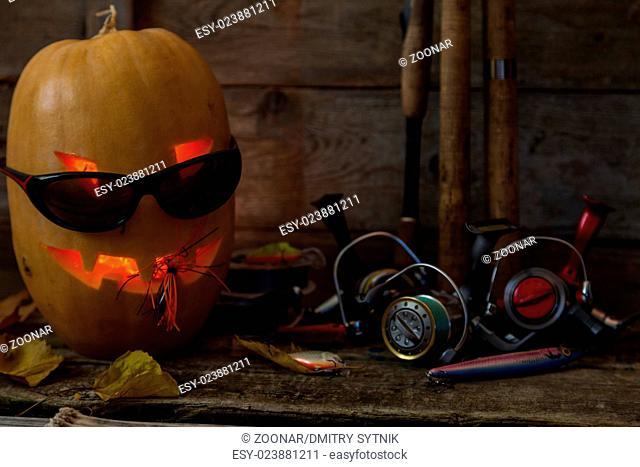 halloween pumpkin head with fishing tackles