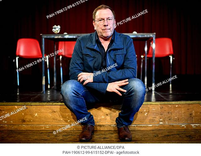 "12 June 2019, Berlin: Rene Pollesch, theatre director and author, sits on the sidelines of a press conference on the """"Future of the Volksbühne"""""
