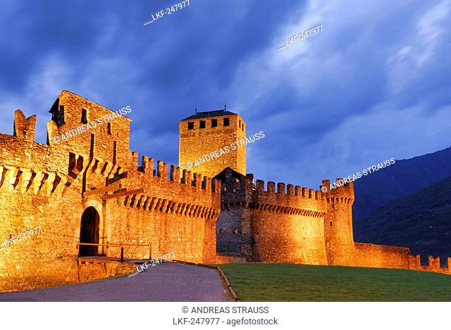 Illuminated castle Castello di Montebello with draw bridge in UNESCO World Heritage Site Bellinzona, Bellinzona, Ticino, Switzerland