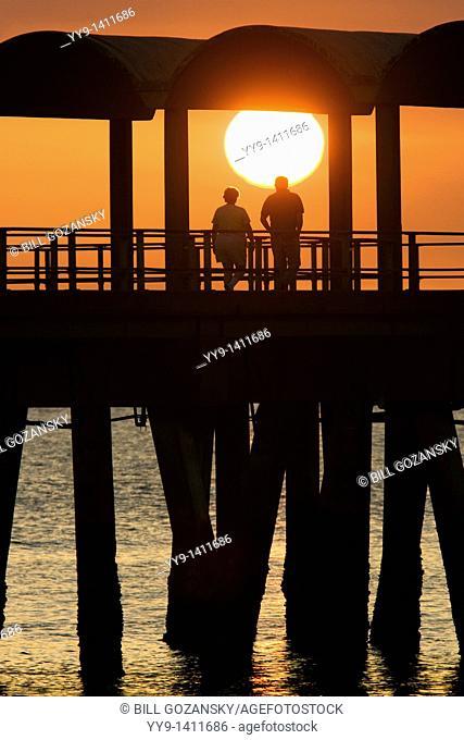 Couple watching sunset on pier- Jekyll Island, Georgia