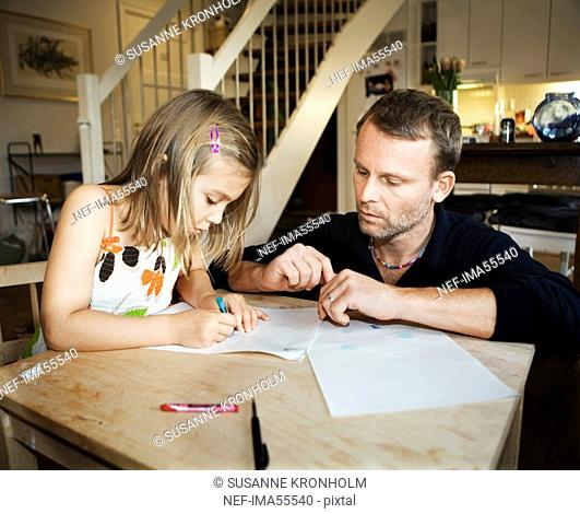Father and daughter painting together Sweden