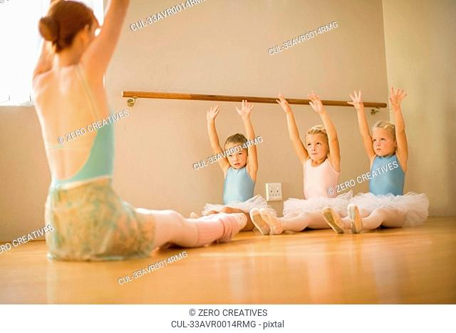 Girls stretching in ballet class