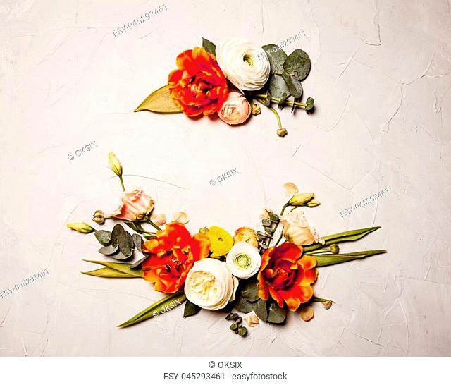 Creative orange and beige flowers flat lay border for holiday greetings