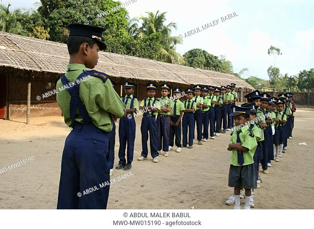 Students attend to the morning drill, at 'Naf KG And Pre Cadet School', in Teknaf, Cox's Bazar, Bangladesh March 22, 2008