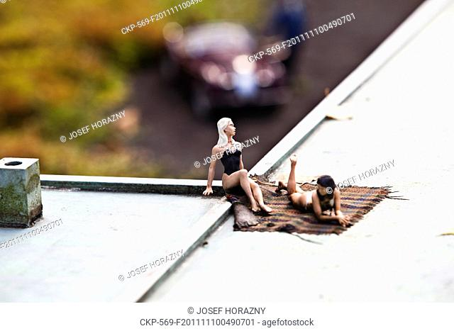 Women figurines sunbathing themselves on the roof of departure lounge of Stara Ruzyne airport in the Boheminium Park in Marianske Lazne Pictured on September 20