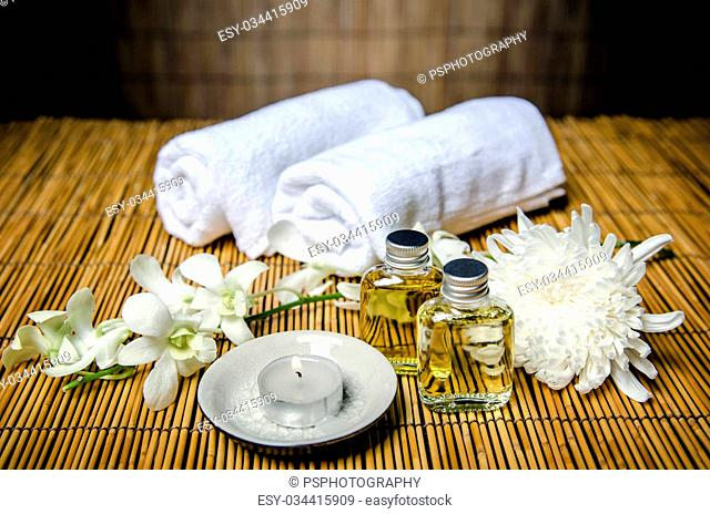 Spa product, massage oil and towels