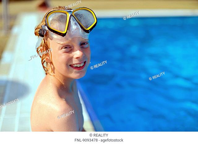 A boy with diving goggles in an open air bath