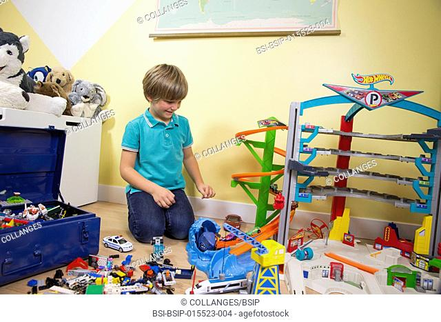 A child playing in his room