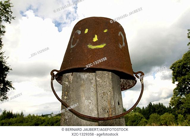 Upended bucket with smiley face
