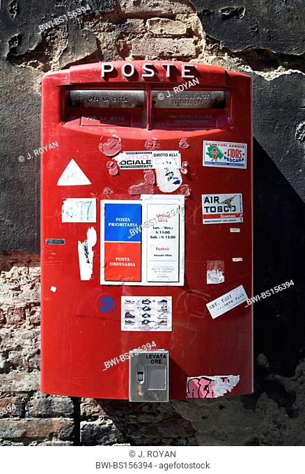 post box covered with stamps, Italy, Siena