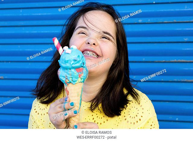 Teenager girl with down syndrome enjoying an ice cream
