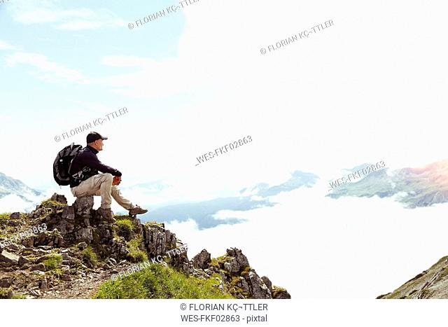 Austria, South Tyrol, hiker lookint at view