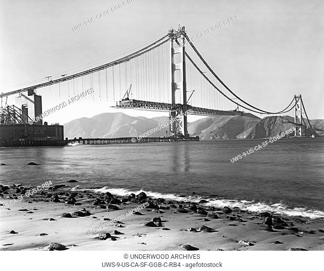 San Francisco, California: 1937.View from Crissy Field of the construction of the Golden Gate Bridge with the roadbed beiing installed