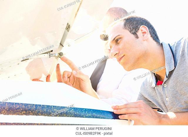 Pilot inspecting aircraft before flight