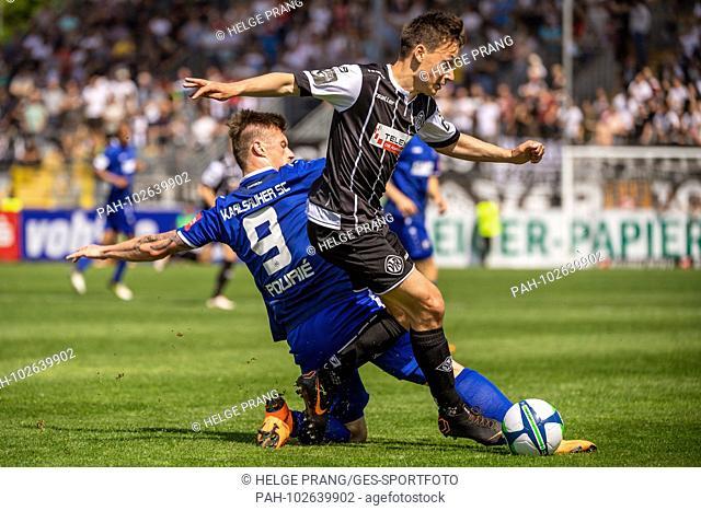 Noah Feil (Aalen) duels with Marvin Pourie (KSC). GES / Soccer / 3rd Bundesliga: GES / Soccer / VfR Aalen - Karlsruher SC, 05.05