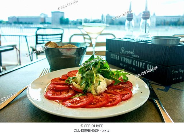 Tomato and Mozzarella salad and Ciabatta bread in cafe by River Danube, Budapest, Hungary
