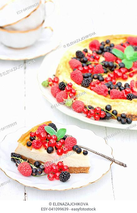 Cheesecake with summer berries and mint