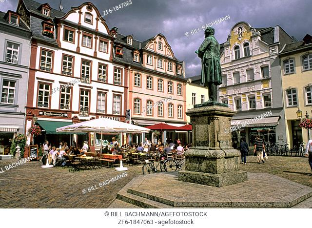 Germany Koblenz Old Town Center with buildings cafes and statue of Johannes Muller