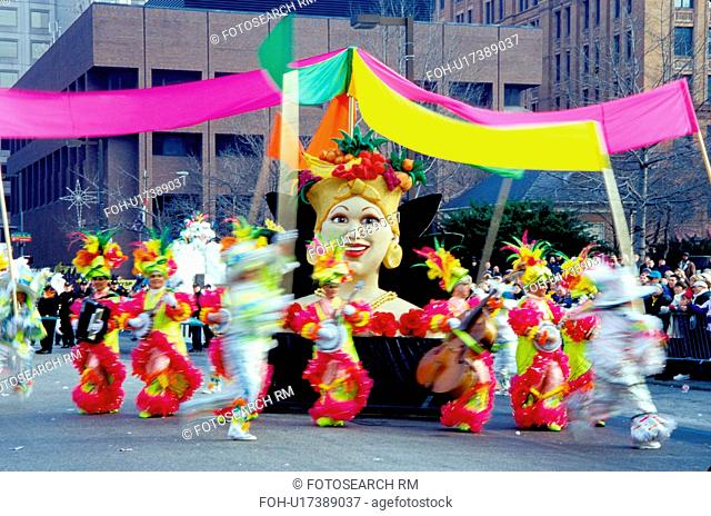 parade, band, costume, Philadelphia, PA, Pennsylvania, Members of a String Band dressed in fancy colorful costumes with feathers play their instruments and...