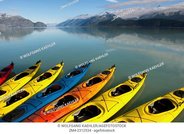 Sea kayaks next to cruise ship Safari Endeavour with Tarr Inlet and the Grand Pacific Glacier in background in Glacier Bay National Park, Southeast Alaska, USA