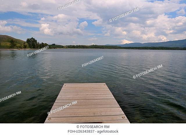 water boat dock jutting out lake in waterton