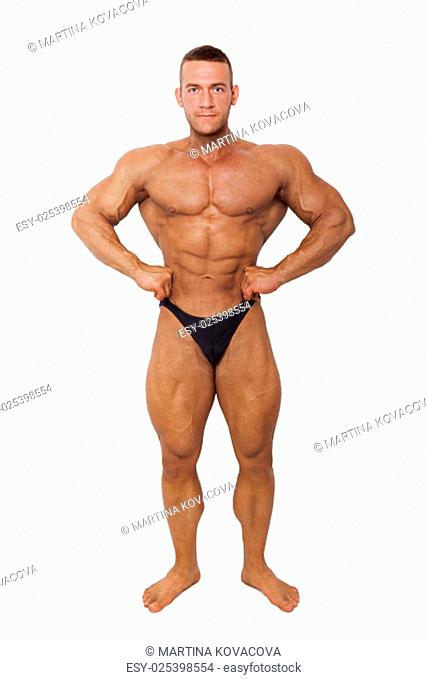 Bodybuilder posing. Huge sexy muscular bodybuilder posing isolated on white background. Sports and fitness