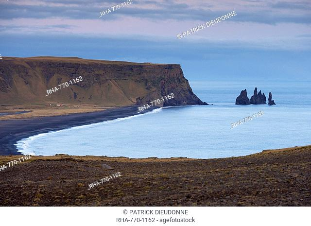 Black sand beach, rock formation and Reynisdrangar sea stacks in the distance, from Dyrholaey near Vik, Iceland, Polar Regions