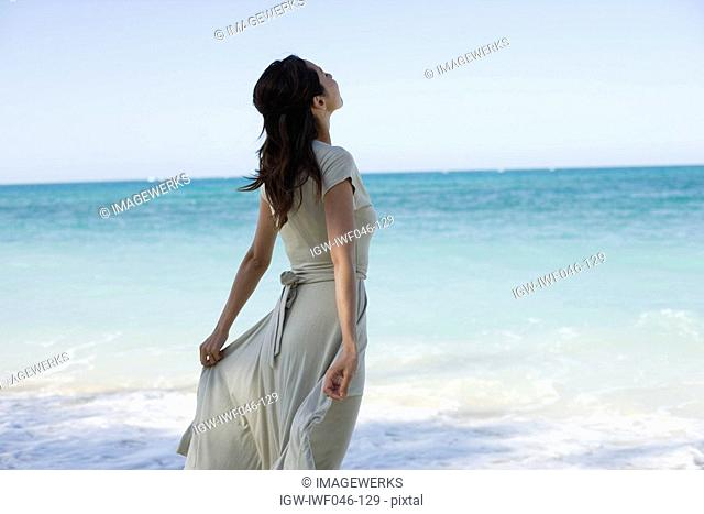 A young woman standing on beach