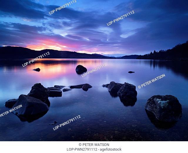 Scotland, Perthshire, Rannoch Moor. Still waters on Loch Rannoch at sunset