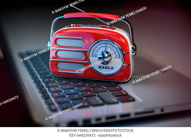 Online radio live. Vintage radio on laptop keyboard. 3d illustration