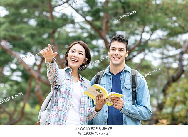 Young harmonious couple in casual clothes