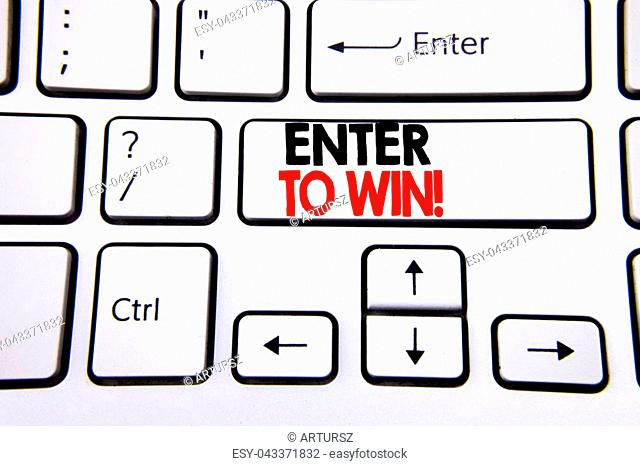 Hand writing text caption inspiration showing Enter to Win. Business concept for Winning in Competition written on white keyboard key with copy space