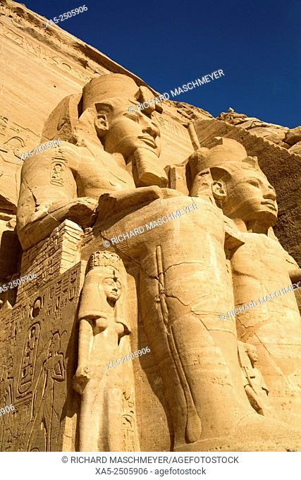 Queen Nefertari (smaller statue, below), Colossi of Ramses II, Sun Temple, Abu Simbel, Egypt