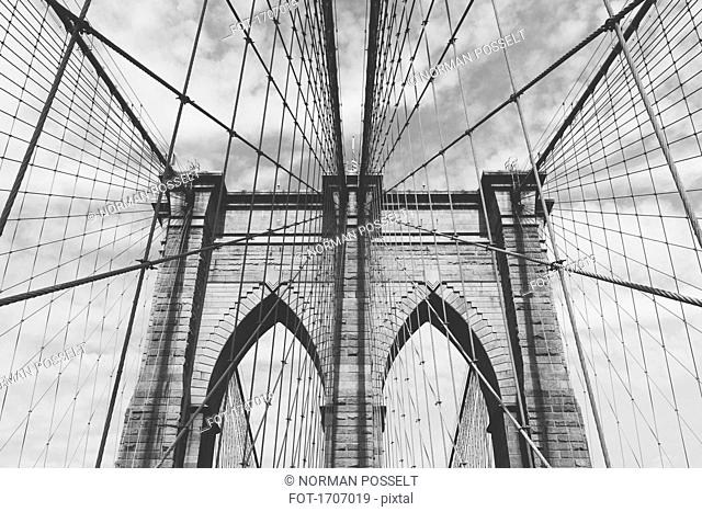 Low angle view of Brooklyn Bridge against sky, New York City, New York, USA