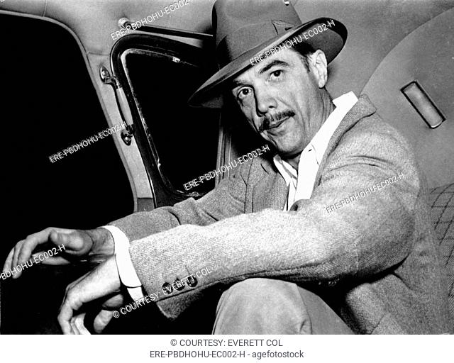 Howard Hughes, wearing good luck hat, 1947