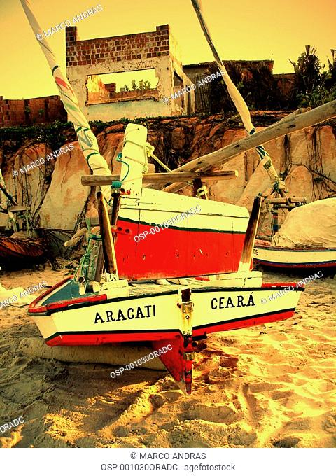 ceara beach shore with an anchored boat