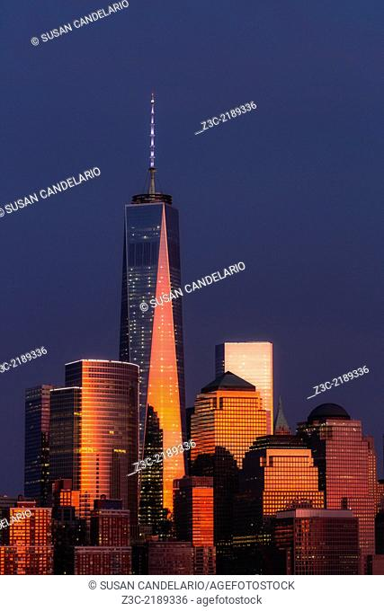One World Trade Center commonly referred to as the Freedom Tower and other Financial District skyscrapers are bathed in golden light during the last light at...