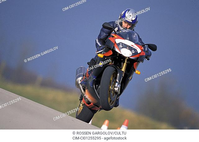 Aprilia RSV mille R, Sports motor cycle, Sportsman, black-red, model year 2003, from the front, driving, Front wheel in the air, Wheely, High starter