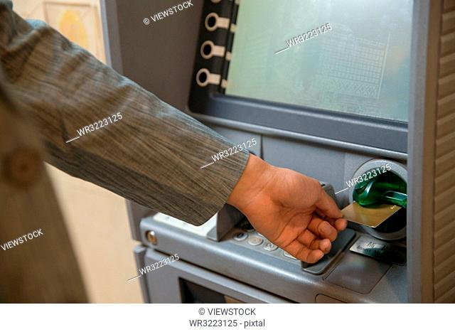 Young men use atms