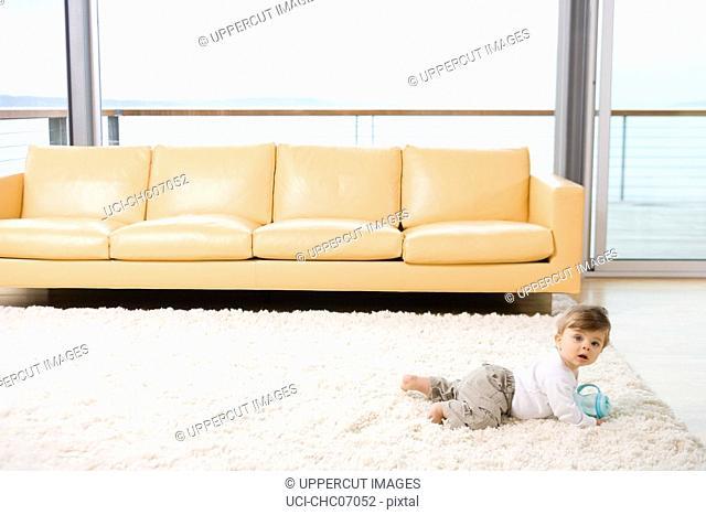 Baby crawling on rug